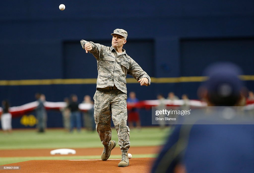 Col. Daniel H. Tulley, Commander, 6th Air Mobility Wing, MacDill Air Force Base, Florida, throws out a ceremonial first pitch before the start of a game between the Tampa Bay Rays and the Toronto Blue Jays on May 1, 2016 at Tropicana Field in St. Petersburg, Florida.