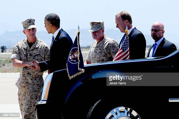 Col John Farnham Commander of MCAS Miramar shakes hands with President Barack Obama shortly after his arrival at MCAS Miramar aboard Air Force One on...