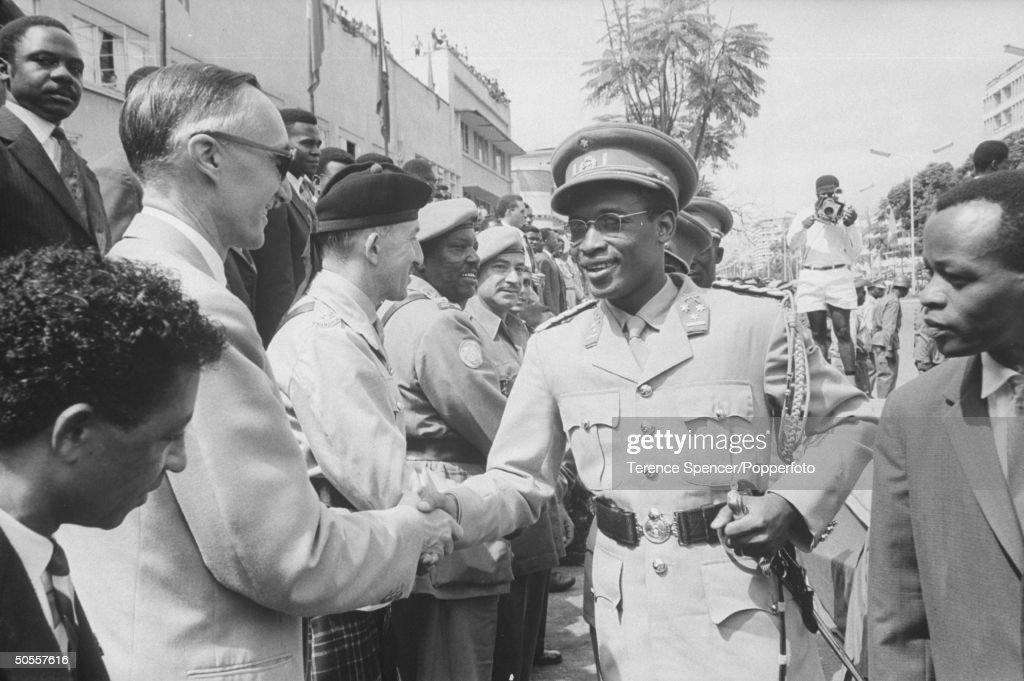 Col. Joseph Mobuto (C).