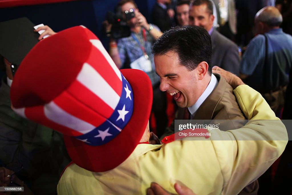 Col. Oscar Poole of Georgia puts his arm around Wisconsin Gov. <a gi-track='captionPersonalityLinkClicked' href=/galleries/search?phrase=Scott+Walker+-+Politiek&family=editorial&specificpeople=7511934 ng-click='$event.stopPropagation()'>Scott Walker</a> during the third day of the Republican National Convention at the Tampa Bay Times Forum on August 29, 2012 in Tampa, Florida. Former Massachusetts Gov. Mitt Romney was nominated as the Republican presidential candidate during the RNC, which is scheduled to conclude August 30.