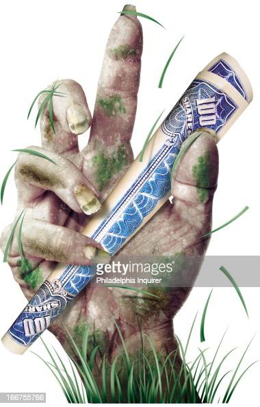 3 col x 9 in / 146x229 mm / 497x778 pixels Robert West color illustration of gruesome hand emerging from the grass holding onto a 'zombie' stock a...