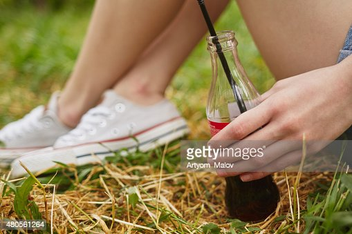 Cola in girl's hand : Stock Photo