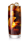 Glass of cocktail with cola, rum and limes slices isolated on white background