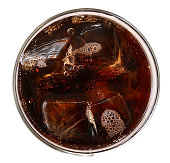 Cola with ice cubes in glass top view isolated on white background, clipping path included