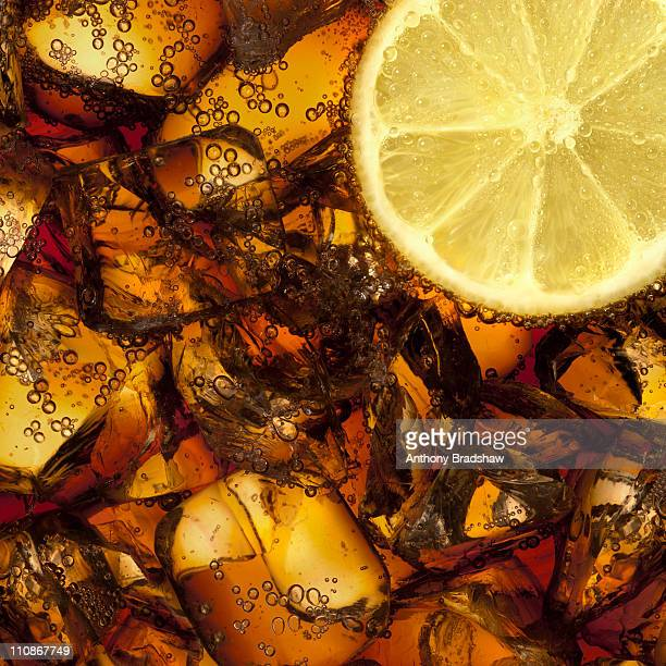 Cola with lemon and ice