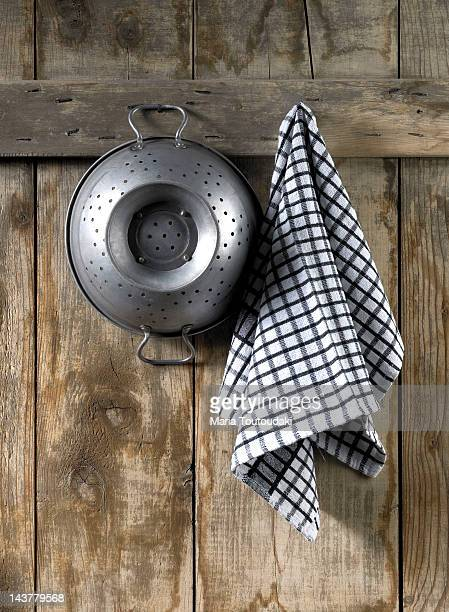Colander and dishcloth hanging