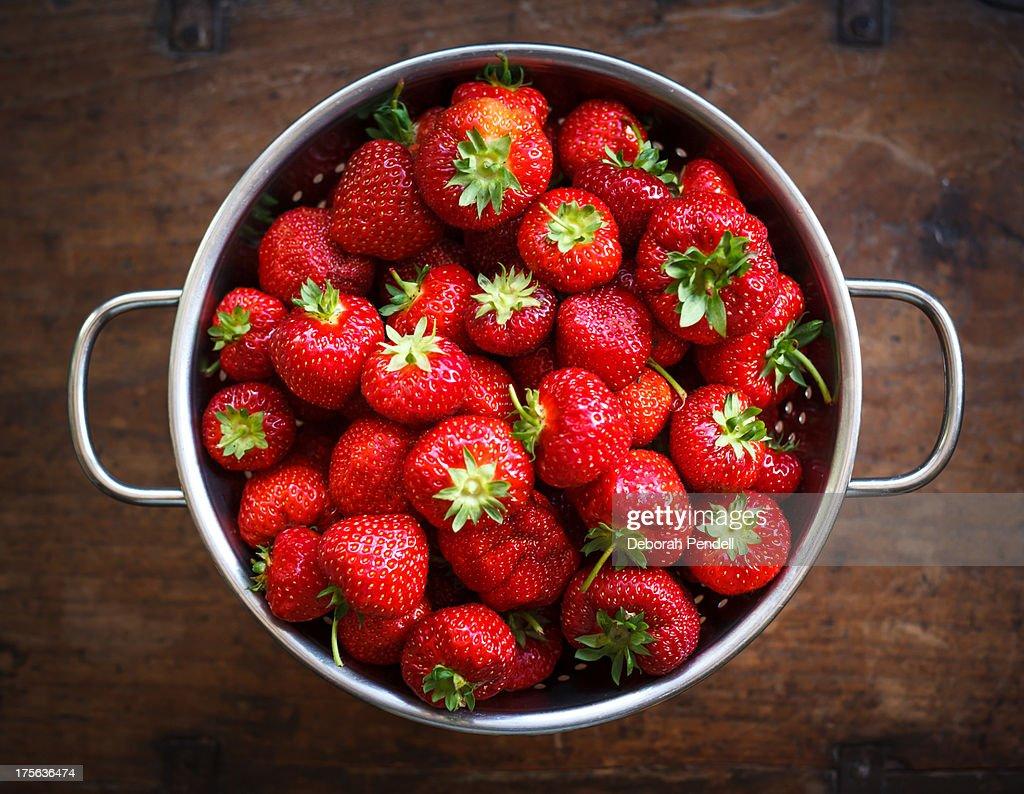 Colander full of ripe strawberries