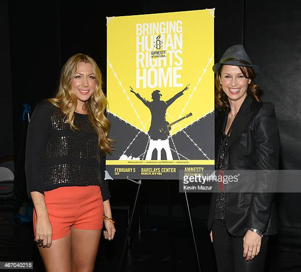 Colbie Caillat and Bridget Moynahan attend the Amnesty International Concert presented by the CBGB Festival at Barclays Center on February 5 2014 in...