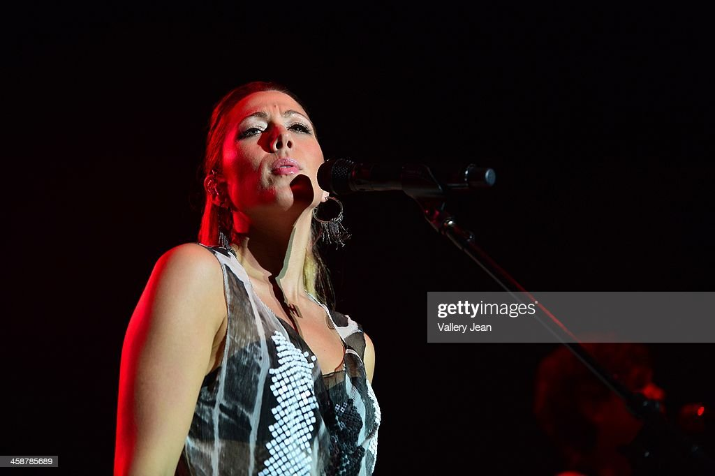 <a gi-track='captionPersonalityLinkClicked' href=/galleries/search?phrase=Colbie+Caillat&family=editorial&specificpeople=4410812 ng-click='$event.stopPropagation()'>Colbie Caillat</a> performs in the 7th Annual No Snow Ball concert presented by 97.9 WRMF and Sunny 107.9 at Mizner Park Amphitheatre on December 14, 2013 in Boca Raton, Florida.
