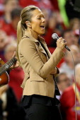 Colbie Caillat performs the national anthem duing pregame ceremonies for Game Three of the 2013 World Series between the St Louis Cardinals and the...