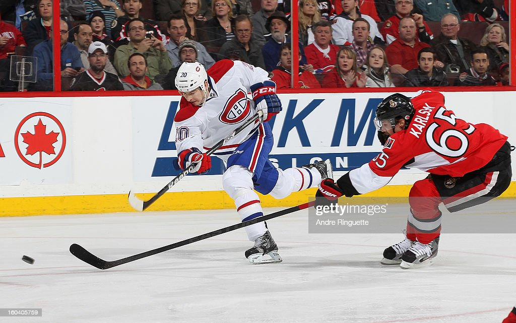 <a gi-track='captionPersonalityLinkClicked' href=/galleries/search?phrase=Colby+Armstrong&family=editorial&specificpeople=597839 ng-click='$event.stopPropagation()'>Colby Armstrong</a> #20 of the Montreal Canadiens fires a slapshot past the outstretched stick of <a gi-track='captionPersonalityLinkClicked' href=/galleries/search?phrase=Erik+Karlsson&family=editorial&specificpeople=5370939 ng-click='$event.stopPropagation()'>Erik Karlsson</a> #65 of the Ottawa Senators on January 30, 2013 at Scotiabank Place in Ottawa, Ontario, Canada.