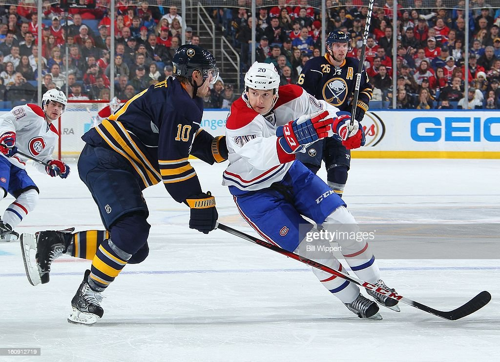 <a gi-track='captionPersonalityLinkClicked' href=/galleries/search?phrase=Colby+Armstrong&family=editorial&specificpeople=597839 ng-click='$event.stopPropagation()'>Colby Armstrong</a> #20 of the Montreal Canadiens tries to skate around <a gi-track='captionPersonalityLinkClicked' href=/galleries/search?phrase=Christian+Ehrhoff&family=editorial&specificpeople=214788 ng-click='$event.stopPropagation()'>Christian Ehrhoff</a> #10 of the Buffalo Sabres on February 7, 2013 at the First Niagara Center in Buffalo, New York.