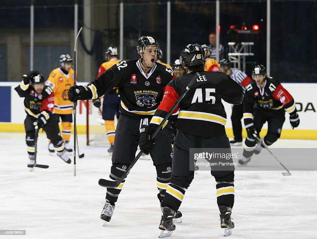 Colby Cohen #52 and Steve Lee #45 of Nottinghm Panthers celebrate the first Panthers goal during the Champions Hockey League group stage game at the National Ice Centre in Nottingham, between Nottingham Panthers and Lukko Rauma on August 22, 2014 in Nottingham, United Kingdom.