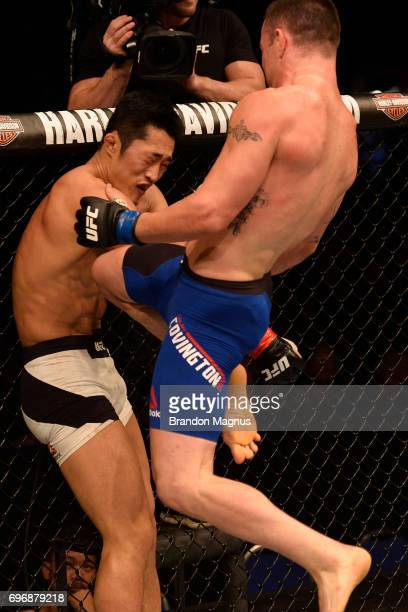 Colby Covington lands a flying knee against Dong Hyun Kim of South Korea in their welterweight bout during the UFC Fight Night event at the Singapore...