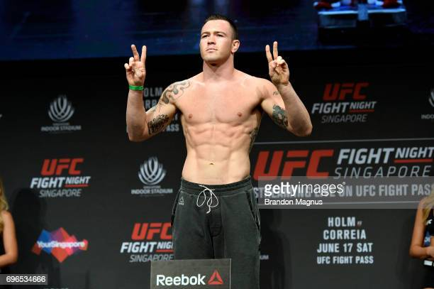 Colby Covington of the United States poses on the scale during the UFC Fight Night weighin at the Marina Bay Sands on June 16 2017 in Singapore