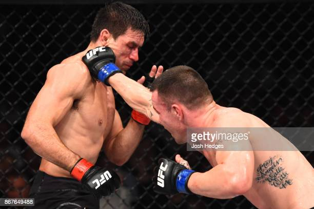 Colby Covington punches Demian Maia of Brazil in their welterweight bout during the UFC Fight Night event inside the Ibirapuera Gymnasium on October...