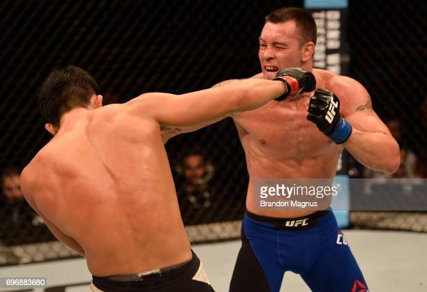 Colby Covington punches Dong Hyun Kim of South Korea in their welterweight bout during the UFC Fight Night event at the Singapore Indoor Stadium on...