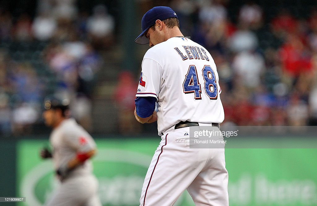<a gi-track='captionPersonalityLinkClicked' href=/galleries/search?phrase=Colby+Lewis&family=editorial&specificpeople=834318 ng-click='$event.stopPropagation()'>Colby Lewis</a> #48 of the Texas Rangers steps off the mound after giving up a two-run home run against Adrian Gonzalez #28 of the Boston Red Sox at Rangers Ballpark in Arlington on August 23, 2011 in Arlington, Texas.