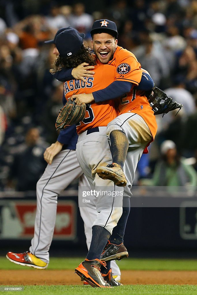 <a gi-track='captionPersonalityLinkClicked' href=/galleries/search?phrase=Colby+Rasmus&family=editorial&specificpeople=3988372 ng-click='$event.stopPropagation()'>Colby Rasmus</a> #28 and <a gi-track='captionPersonalityLinkClicked' href=/galleries/search?phrase=Jose+Altuve&family=editorial&specificpeople=7934195 ng-click='$event.stopPropagation()'>Jose Altuve</a> #27 of the Houston Astros celebrate defeating the New York Yankees in the American League Wild Card Game at Yankee Stadium on October 6, 2015 in New York City. The Astros defeated the Yankees with a score of 3 to 0.