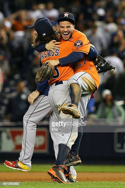 Colby Rasmus and Jose Altuve of the Houston Astros celebrate defeating the New York Yankees in the American League Wild Card Game at Yankee Stadium...