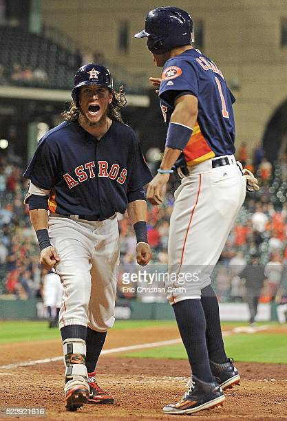 Colby Rasmus of the Houston Astros celebrates his gametying tworun home run with Carlos Correa during the ninth inning against the Boston Red Sox at...