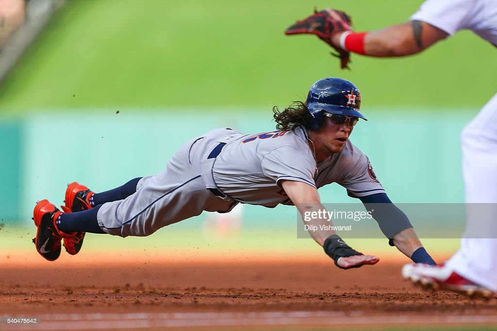 <a gi-track='captionPersonalityLinkClicked' href=/galleries/search?phrase=Colby+Rasmus&family=editorial&specificpeople=3988372 ng-click='$event.stopPropagation()'>Colby Rasmus</a> #28 of the Houston Astros dives back to first base in an attempt to avoid being doubled up against the St. Louis Cardinals in the second inning at Busch Stadium on June 15, 2016 in St. Louis, Missouri. Rams was out on the play.