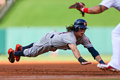 Colby Rasmus of the Houston Astros dives back to first base in an attempt to avoid being doubled up against the St Louis Cardinals in the second...
