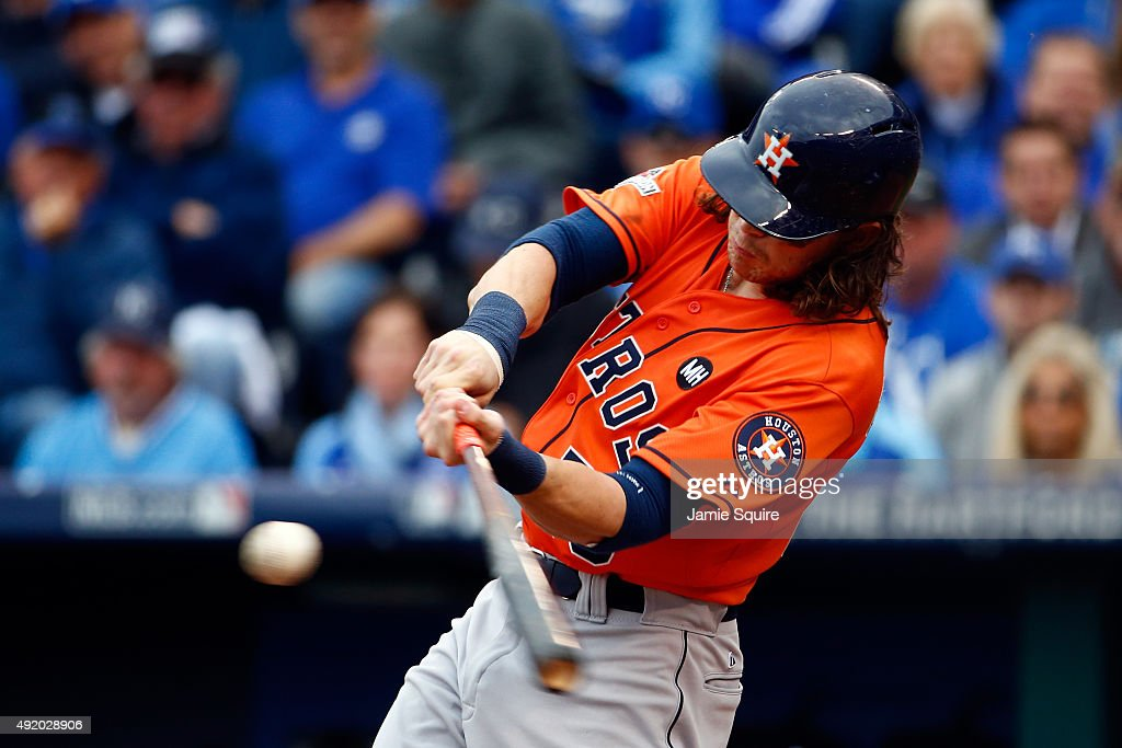Colby Rasmus of the Houston Astros hits a solo home run in the third inning against Johnny Cueto of the Kansas City Royals during game two of the...