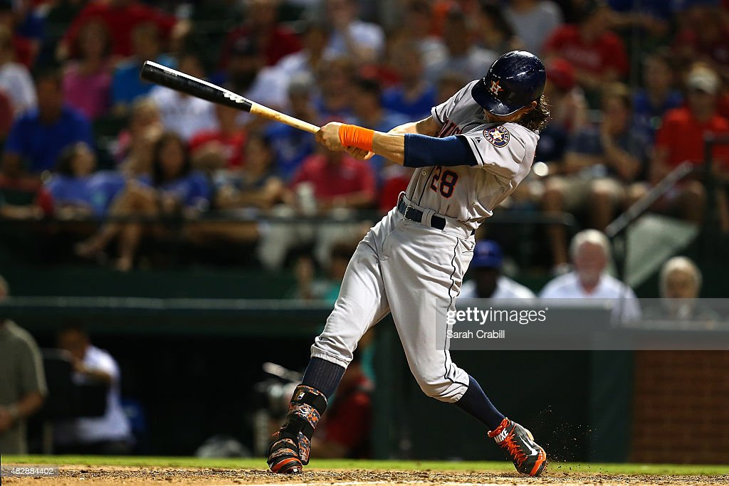 Colby Rasmus #28 of the Houston Astros hits a two-run RBI triple in the seventh inning during a game against the Texas Rangers at Globe Life Park in Arlington on August 3, 2015 in Arlington, Texas.
