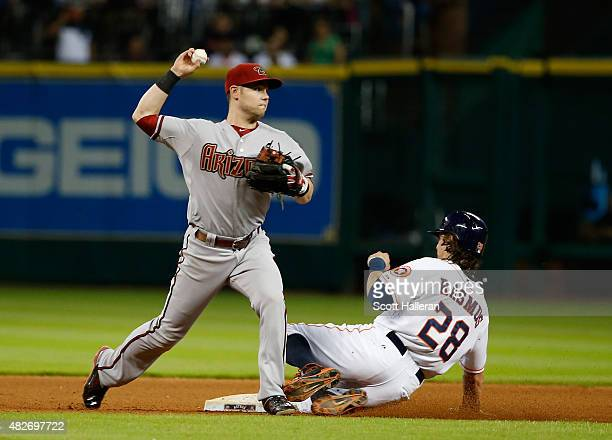 Colby Rasmus of the Houston Astros is forced out at second base in the seventh inning by Chris Owings of the Arizona Diamondbacksduring their game at...