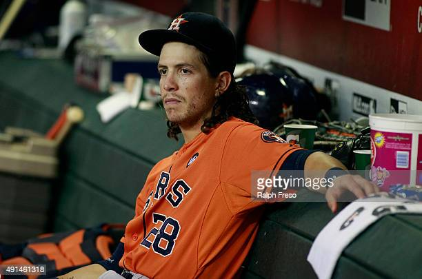 Colby Rasmus of the Houston Astros looks on from the dugout during the eighth inning of a MLB game against the Arizona Diamondbacks at Chase Field on...
