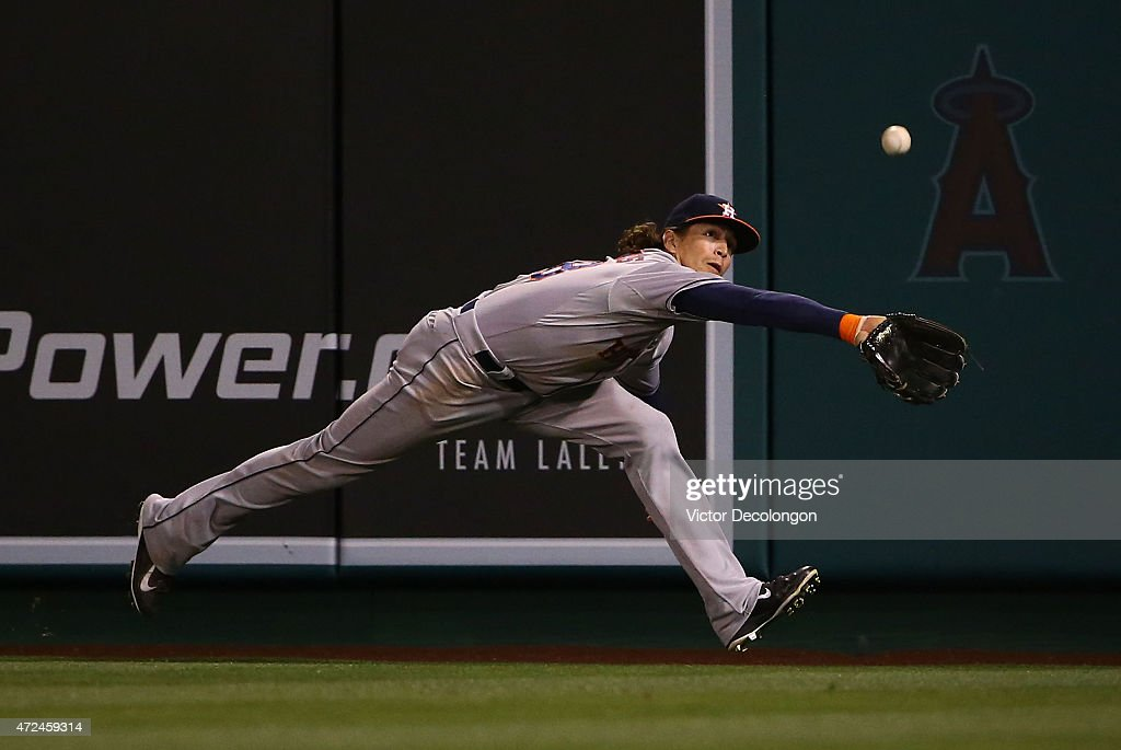 <a gi-track='captionPersonalityLinkClicked' href=/galleries/search?phrase=Colby+Rasmus&family=editorial&specificpeople=3988372 ng-click='$event.stopPropagation()'>Colby Rasmus</a> #28 of the Houston Astros tracks down a fly ball to right field for the first out in the seventh inning during the MLB game against the Los Angeles Angels of Anaheim at Angel Stadium of Anaheim on May 7, 2015 in Anaheim, California. Rasmus made the catch.