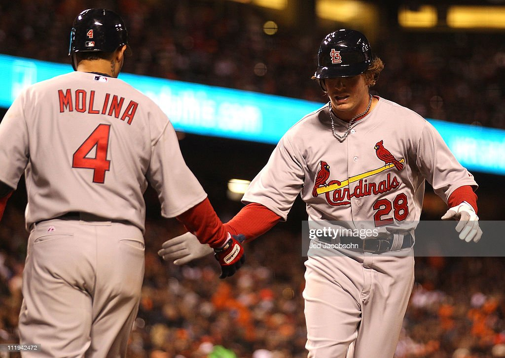 <a gi-track='captionPersonalityLinkClicked' href=/galleries/search?phrase=Colby+Rasmus&family=editorial&specificpeople=3988372 ng-click='$event.stopPropagation()'>Colby Rasmus</a> #28 of the St. Louis Cardinals celebrates with <a gi-track='captionPersonalityLinkClicked' href=/galleries/search?phrase=Yadier+Molina&family=editorial&specificpeople=172002 ng-click='$event.stopPropagation()'>Yadier Molina</a> #4 after hitting a home run against the San Francisco Giants at AT&T Park on April 9, 2011 in San Francisco, California.