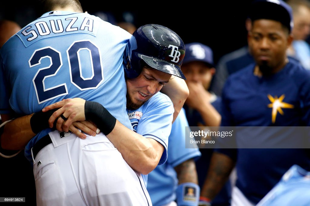 Colby Rasmus #28 of the Tampa Bay Rays celebrates his home run in the dugout by lifting up teammate Steven Souza Jr. #20 during the sixth inning of a game against the Oakland Athletics on June 11, 2017 at Tropicana Field in St. Petersburg, Florida.