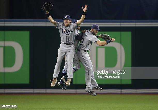 Colby Rasmus of the Tampa Bay Rays celebrates their victory with Mallex Smith and Steven Souza Jr #20 during MLB game action against the Toronto Blue...
