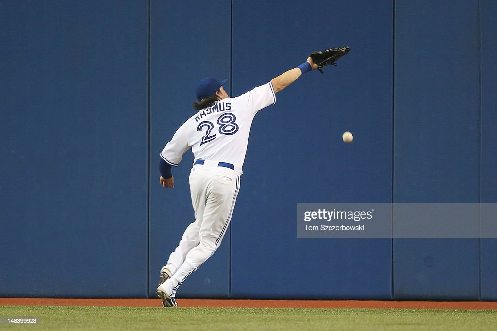 <a gi-track='captionPersonalityLinkClicked' href=/galleries/search?phrase=Colby+Rasmus&family=editorial&specificpeople=3988372 ng-click='$event.stopPropagation()'>Colby Rasmus</a> #28 of the Toronto Blue Jays cannot get to a double in the 9th inning by Michael Brantley #23 of the Cleveland Indians on July 15, 2012 at Rogers Centre in Toronto, Ontario, Canada.