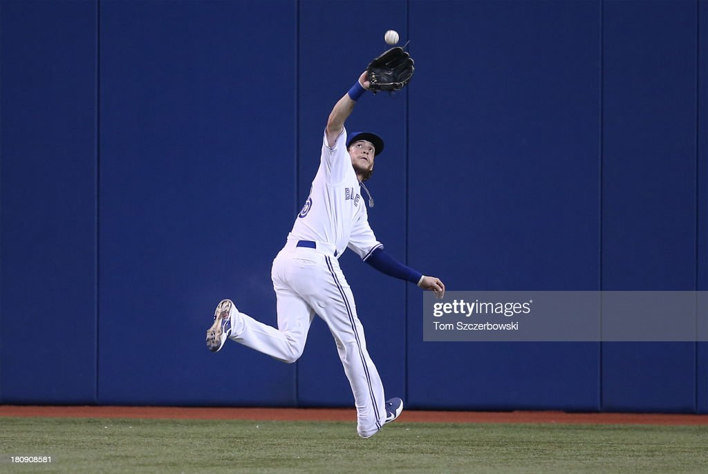 <a gi-track='captionPersonalityLinkClicked' href=/galleries/search?phrase=Colby+Rasmus&family=editorial&specificpeople=3988372 ng-click='$event.stopPropagation()'>Colby Rasmus</a> #28 of the Toronto Blue Jays catches a fly ball in the second inning during MLB game action against the New York Yankees on September 17, 2013 at Rogers Centre in Toronto, Ontario, Canada.