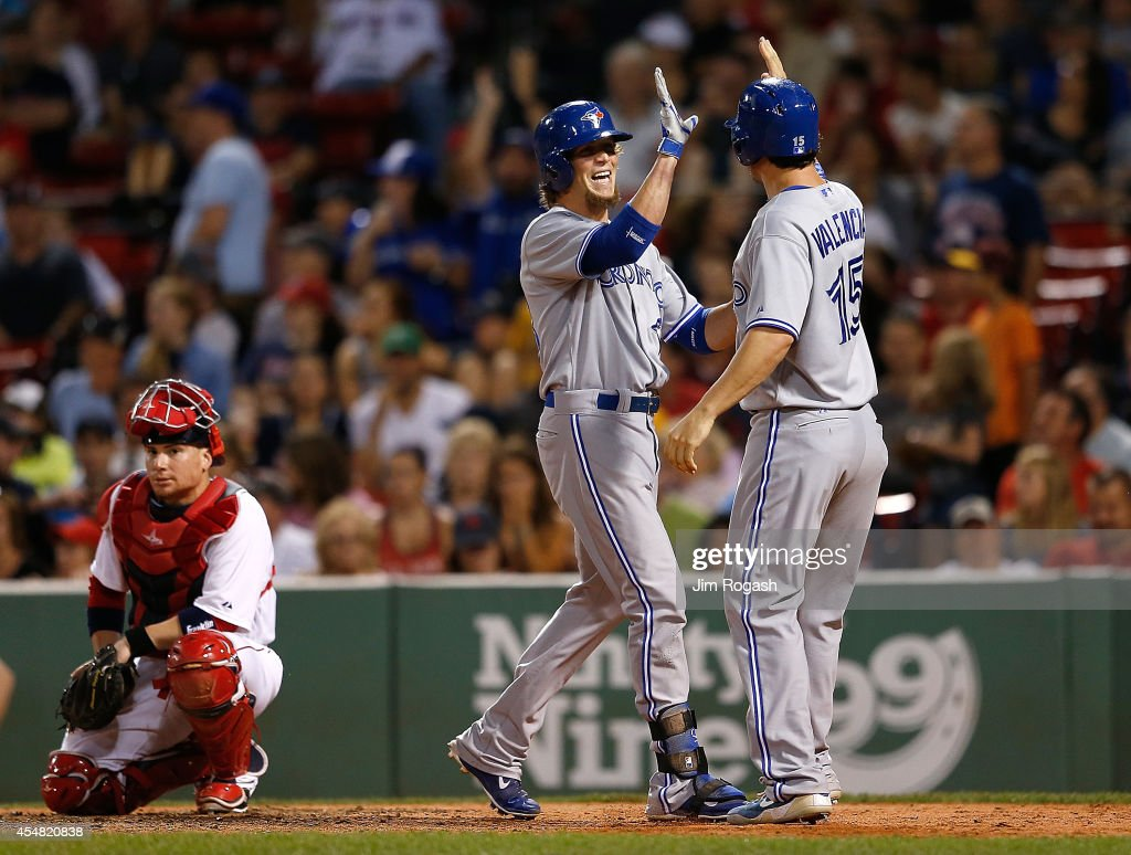 <a gi-track='captionPersonalityLinkClicked' href=/galleries/search?phrase=Colby+Rasmus&family=editorial&specificpeople=3988372 ng-click='$event.stopPropagation()'>Colby Rasmus</a> #28 of the Toronto Blue Jays celebrates his two-run home with <a gi-track='captionPersonalityLinkClicked' href=/galleries/search?phrase=Danny+Valencia&family=editorial&specificpeople=5443820 ng-click='$event.stopPropagation()'>Danny Valencia</a> #15 of the Toronto Blue Jays, who was on base, in the seventh inning against the Boston Red Sox at Fenway Park on September 6, 2014 in Boston, Massachusetts.