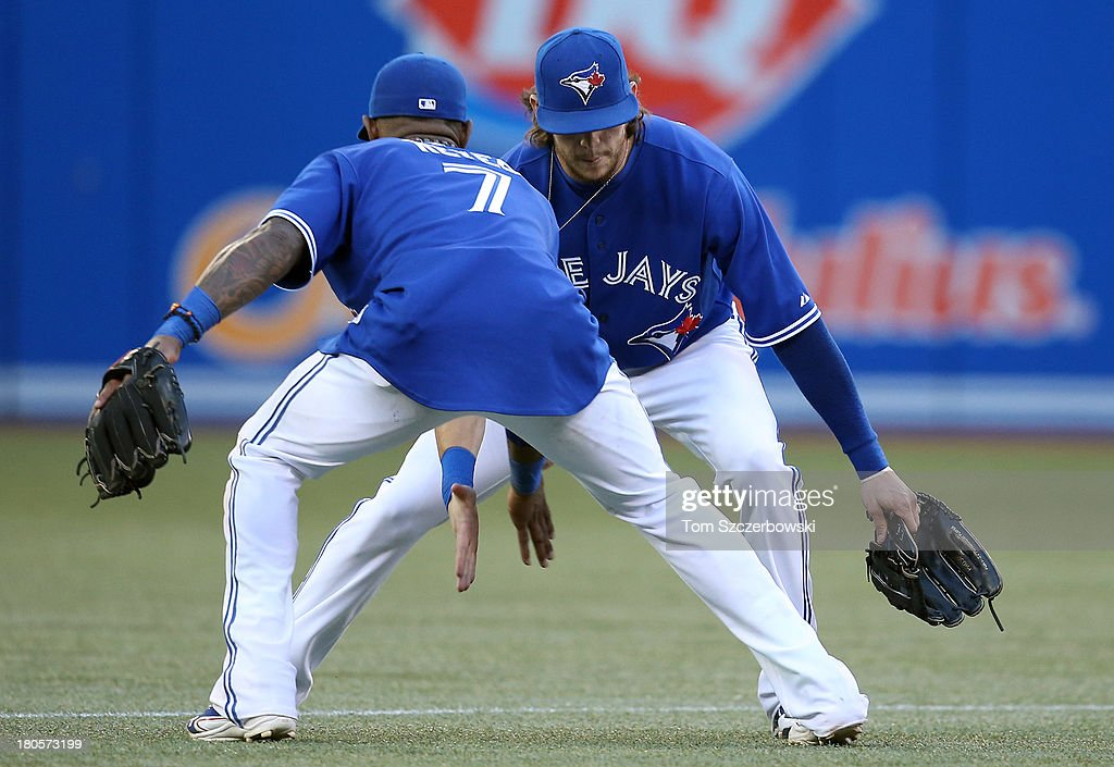 <a gi-track='captionPersonalityLinkClicked' href=/galleries/search?phrase=Colby+Rasmus&family=editorial&specificpeople=3988372 ng-click='$event.stopPropagation()'>Colby Rasmus</a> #28 of the Toronto Blue Jays celebrates their victory with teammate Jose Reyes #7 during MLB game action against the Baltimore Orioles on September 14, 2013 at Rogers Centre in Toronto, Ontario, Canada.