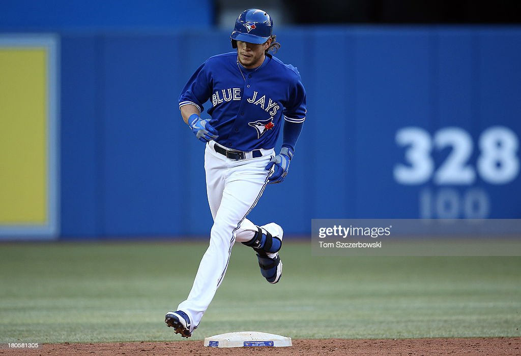 <a gi-track='captionPersonalityLinkClicked' href=/galleries/search?phrase=Colby+Rasmus&family=editorial&specificpeople=3988372 ng-click='$event.stopPropagation()'>Colby Rasmus</a> #28 of the Toronto Blue Jays circles the bases after hitting a two-run home run in the seventh inning during MLB game action against the Baltimore Orioles on September 14, 2013 at Rogers Centre in Toronto, Ontario, Canada.