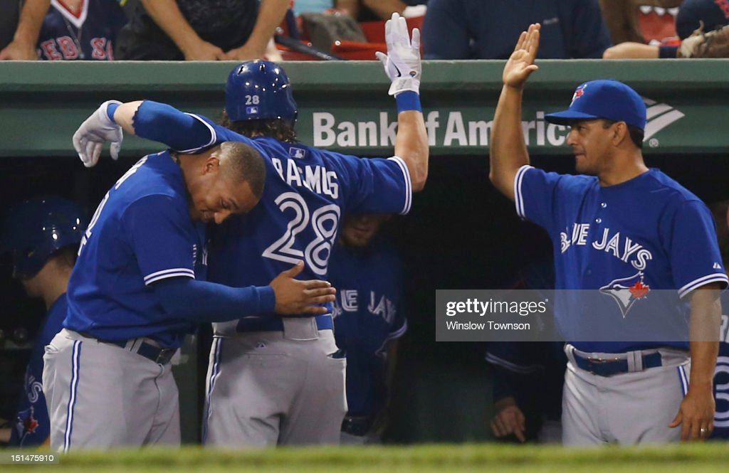 <a gi-track='captionPersonalityLinkClicked' href=/galleries/search?phrase=Colby+Rasmus&family=editorial&specificpeople=3988372 ng-click='$event.stopPropagation()'>Colby Rasmus</a> #28 of the Toronto Blue Jays is congratulated at the dugout after his two run home run by <a gi-track='captionPersonalityLinkClicked' href=/galleries/search?phrase=Moises+Sierra&family=editorial&specificpeople=7509137 ng-click='$event.stopPropagation()'>Moises Sierra</a> #14 of the Toronto Blue Jays, left, and Don Wakamatsu #22 of the Toronto Blue Jays during the ninth inning of the game against the Boston Red Sox at Fenway Park on September 7, 2012 in Boston, Massachusetts.