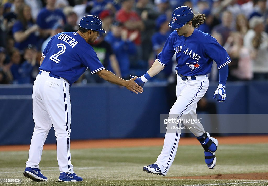 Colby Rasmus #28 of the Toronto Blue Jays is congratulated by third base coach Luis Rivera #2 after hitting a 3-run home run in the sixth inning during MLB game action against the Boston Red Sox on April 6, 2013 at Rogers Centre in Toronto, Ontario, Canada.