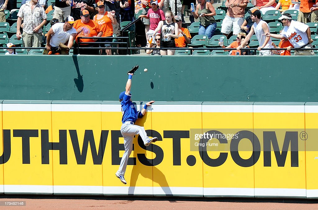 Colby Rasmus #28 of the Toronto Blue Jays tries to catch a home run by Adam Jones #10 (not pictured) of the Baltimore Orioles in the fifth inning at Oriole Park at Camden Yards on July 14, 2013 in Baltimore, Maryland.