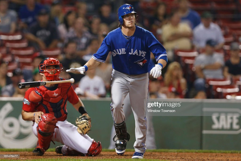 <a gi-track='captionPersonalityLinkClicked' href=/galleries/search?phrase=Colby+Rasmus&family=editorial&specificpeople=3988372 ng-click='$event.stopPropagation()'>Colby Rasmus</a> #28 of the Toronto Blue Jays watches his two run home run with <a gi-track='captionPersonalityLinkClicked' href=/galleries/search?phrase=Jarrod+Saltalamacchia&family=editorial&specificpeople=836404 ng-click='$event.stopPropagation()'>Jarrod Saltalamacchia</a> #39 of the Boston Red Sox during the ninth inning of the game at Fenway Park on September 7, 2012 in Boston, Massachusetts.