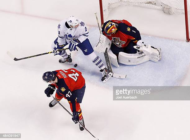 Colby Robak looks back as goaltender Roberto Luongo of the Florida Panthers defends the net against David Clarkson of the Toronto Maple Leafs at the...