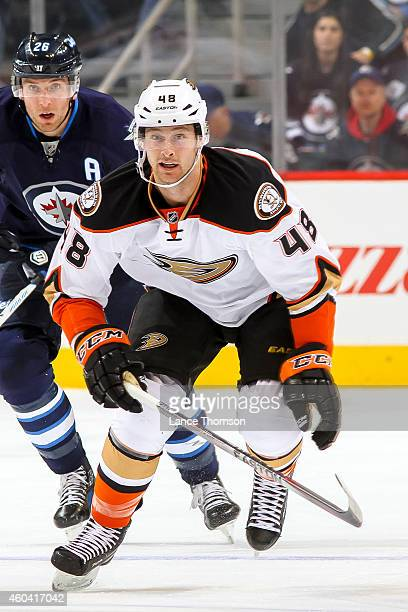 Colby Robak of the Anaheim Ducks follows the play down the ice during first period action against the Winnipeg Jets on December 7 2014 at the MTS...