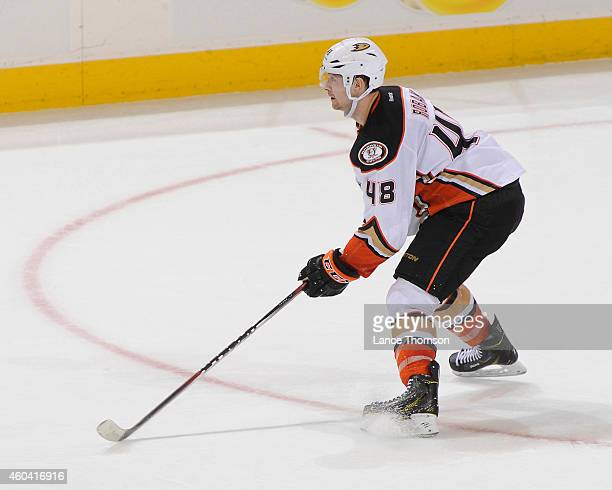 Colby Robak of the Anaheim Ducks keeps an eye on the play during second period action against the Winnipeg Jets on December 7 2014 at the MTS Centre...