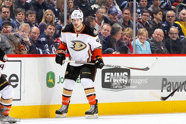 Colby Robak of the Anaheim Ducks keeps an eye on the play during first period action against the Winnipeg Jets on December 7 2014 at the MTS Centre...