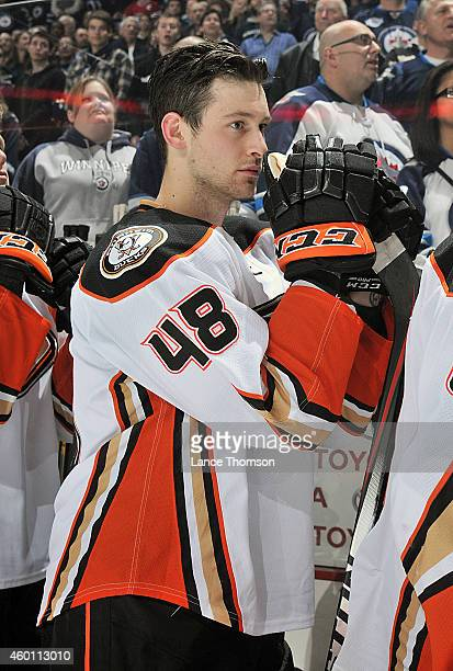 Colby Robak of the Anaheim Ducks looks on from the bench prior to puck drop against the Winnipeg Jets on December 7 2014 at the MTS Centre in...