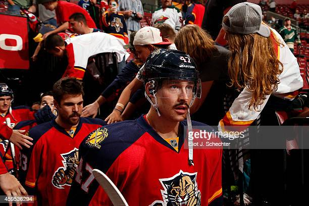 Colby Robak of the Florida Panthers heads out to the ice sporting a mustache against the Minnesota Wild at the BBT Center on November 24 2014 in...